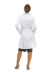 Full length portrait of medical doctor woman. Rear view