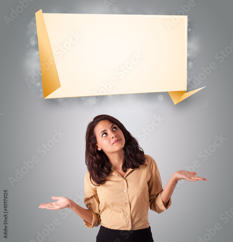 attractive woman lookint modern origami copy space