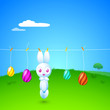 Hanging cute Easter Bunny and painted Easter Eggs in a rope on b