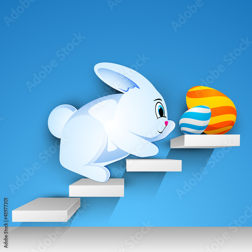 Easter rabbit with beautiful painted Easter eggs on stairs, Happ