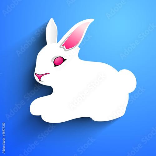 Little Easter rabbit on blue background.