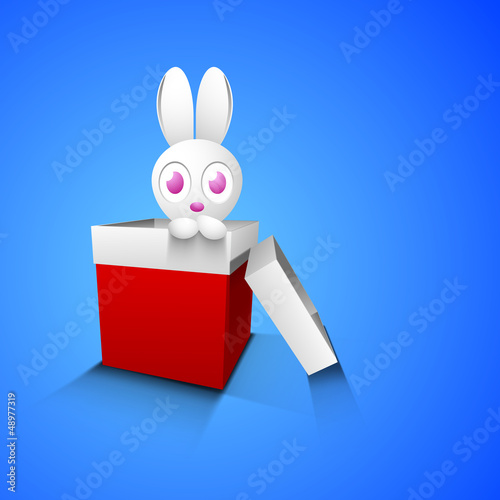 Cute Easter Bunny in red gift box on blue background.