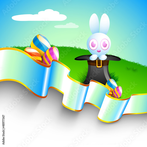 Cute Easter Bunny and painted Easter Eggs with ribbon on beautif