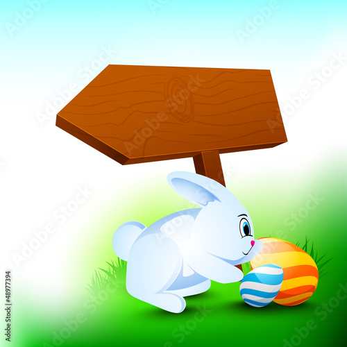 Happy Easter background with little rabbit, painted eggs and woo
