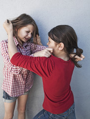 young girls quarrel at school