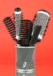 Iron basket with combs and round hair brushes,