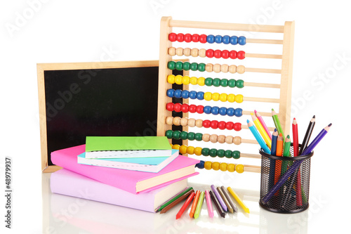 Toy abacus, school desk, books and pencils, isolated on white
