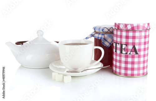 Jar and cup of tea isolated on white