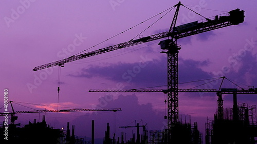 silhouette crane building and twilight time