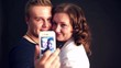 young couple making photo and smiling