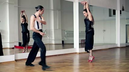 Professional dancers dancing in ballroom