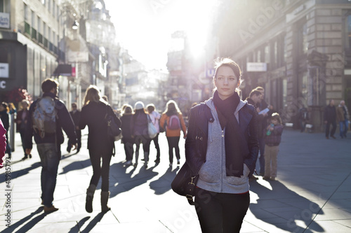 Urban girl striding through city area