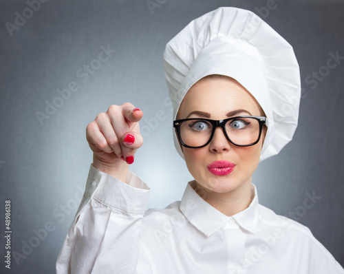 Woman cook chef touching space for your text