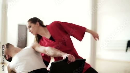 Contemporary professional dancers in ballroom, crane shot