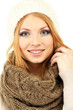 Young beautiful woman wearing winter clothing, isolated on