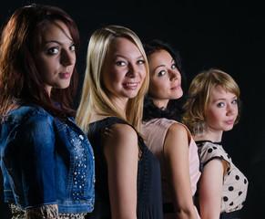 Four stylish beautiful women