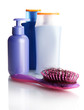 comb brush with lost hair and cosmetics bottles, isolated