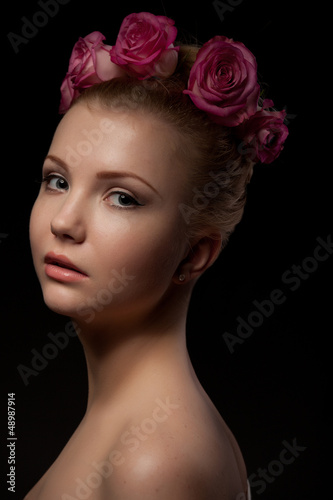 beautiful  young woman beauty shot at dark background