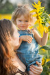 Child with sunflower
