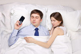 businessman and woman in bed