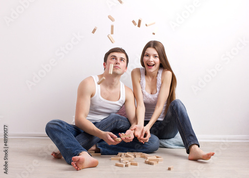 man and woman in new apartment