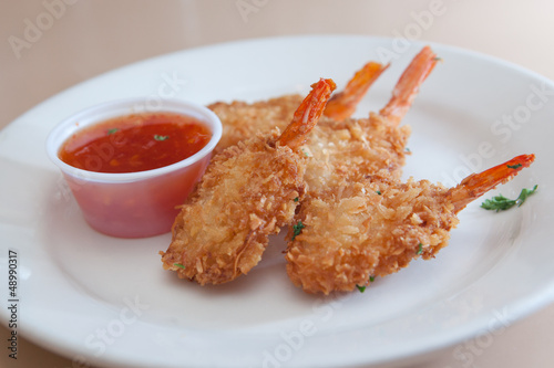 Appetizer plate of fried shrimp and cocktail sauce