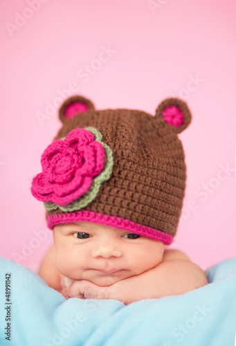 Newborn in knitted hat