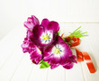 bunch of purple tulips on a  white wooden table