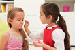 Little girls doing make up