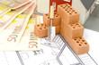 Ziegelsteine mit Plan und Haus