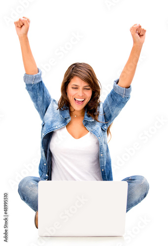 Happy woman with a computer
