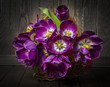 purple tulips in a basket - vintage style