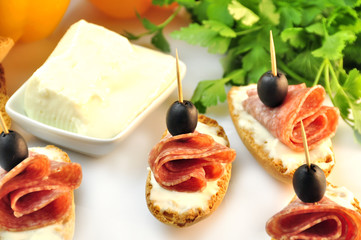 croutons with sliced ​​salami cheese and olives