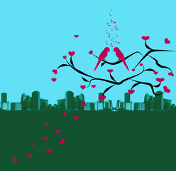 birds in love,standing on a tree and silhouette of the city