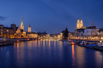 Zurich city center viewed from the river by night