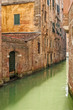 Venice cityscape, narrow water canal and buildings. Italy