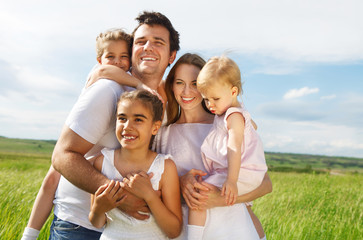 Happy young family with three children