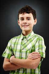 Young boy with his arms folded
