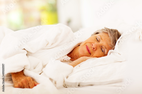 senior woman sleeping on bed