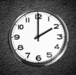 Classic wall clock on black grunge wall