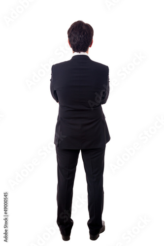 Young business man from the back waiting for something over a wh