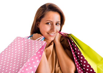 Portrait of a beautiful woman holding shopping bags, isolated on