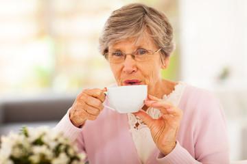 senior woman drinking tea at home