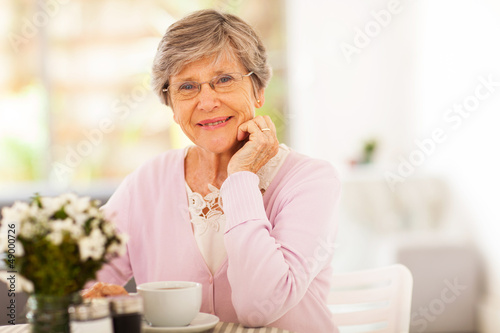 elegant senior woman having tea