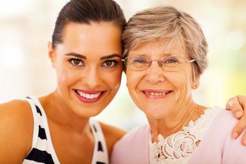 happy woman and senior mother closeup portrait