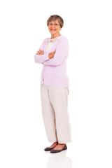 senior woman full length portrait standing on white background