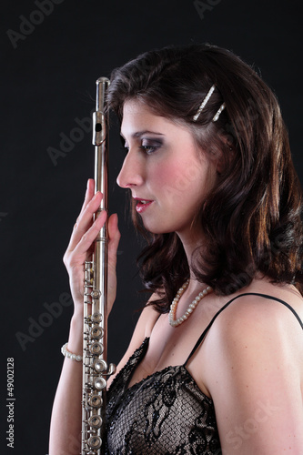 girl and flute on a black background