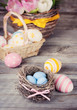 Easter eggs in a nest on a wooden surface