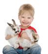 baby boy with rabbits. isolated on white
