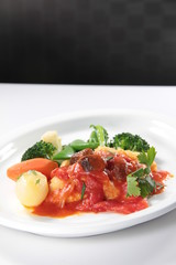 fried fish with tomato sauce